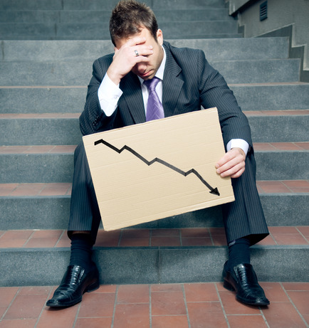 Desperate businessman showing negative graph